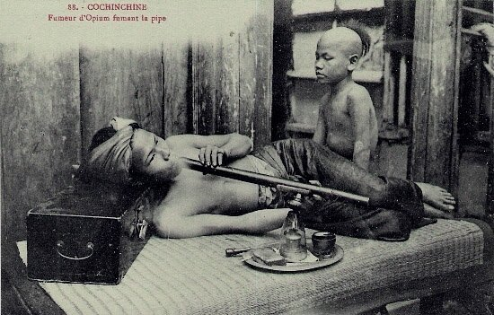 opium smoker and his pipe boy in Indochina